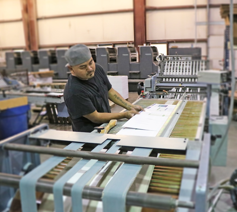 one of our print production staff working on the folder