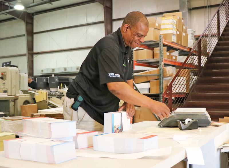 staff member preparing print job for delivery